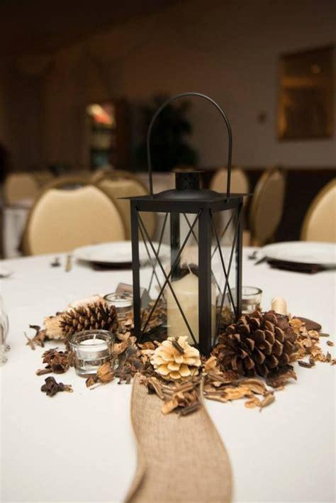 lantern pinecone centerpieces winter wedding centerpieces