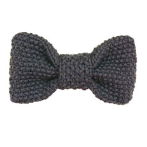 knitted bow pattern free knit hat with ponytail
