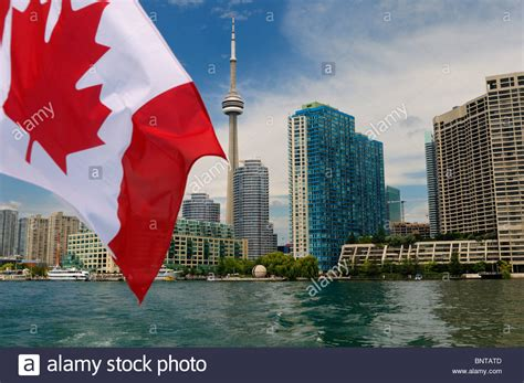 canadian boat flags canadian flag on boat leaving toronto skyline and