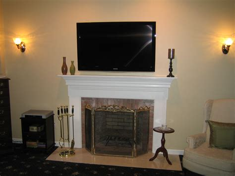 tv mounted on fireplace clinton ct tv install above fireplace in wall wire