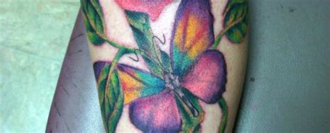 glow in the dark butterfly tattoo glow in the dark rose and butterfly uv blacklight tattoo