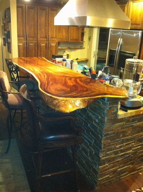 bar top construction stacked stone island with wood slab bar top contemporary kitchen by golin