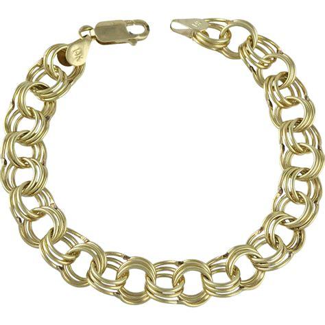 vintage 14k gold link charm bracelet from acanthusantiques