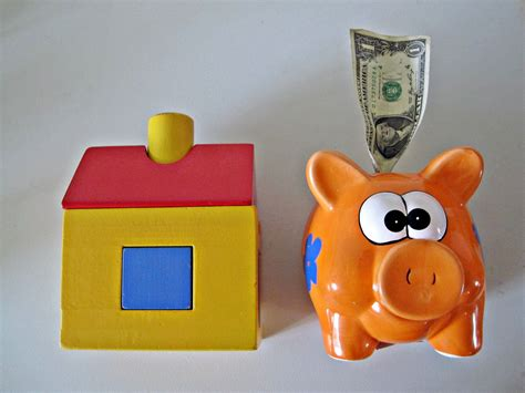 buying a house from the bank buying a house in the usa a piggy bank with a dollar bill flickr