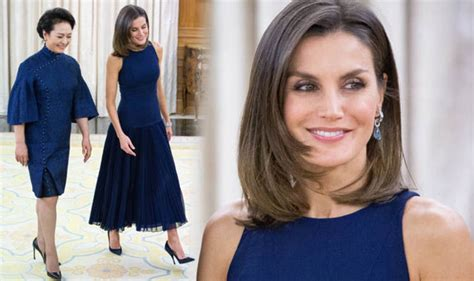 queen letizia of spain pictures stylish royal recycles elegant navy dress uk