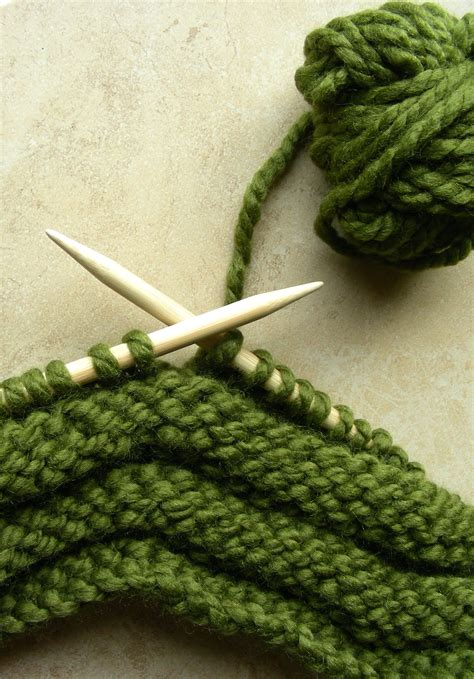 what size knitting needles for a scarf on my knitting needles an olive green button scarf