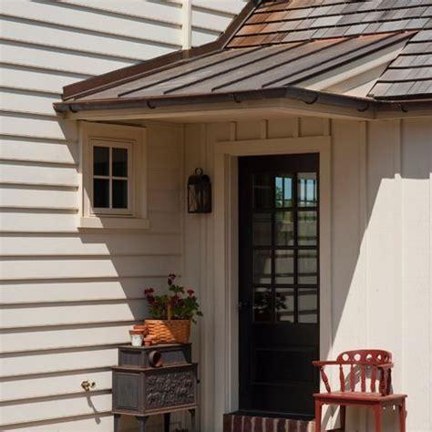garage door front door porch overhang on a slope back door overhangs front doors porch and doors