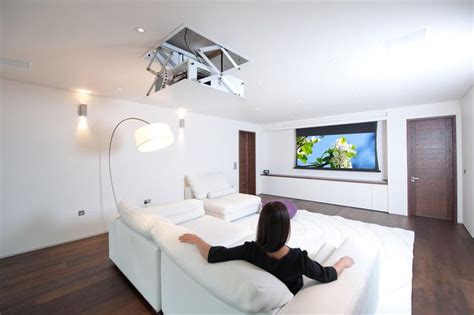 living room projector concealed projector drops from ceiling and projection