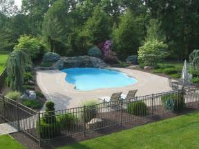 pool landscaping designs traditional swimming pool with fence exterior brick