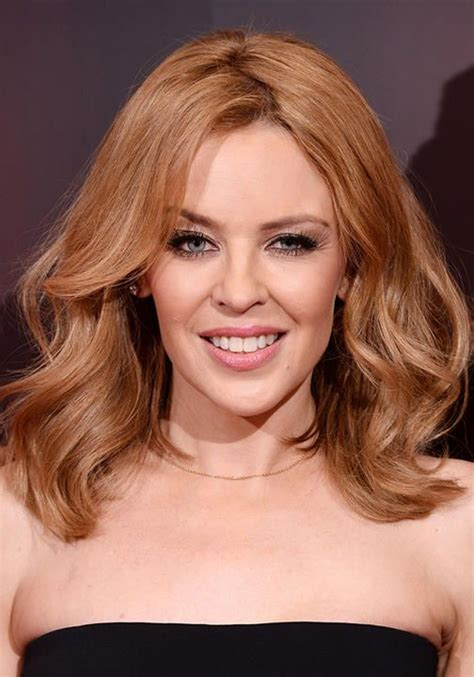 casual chignon updo hairstyle for women kylie minogue hairstyle kylie minogue strawberry blonde inspire pinterest