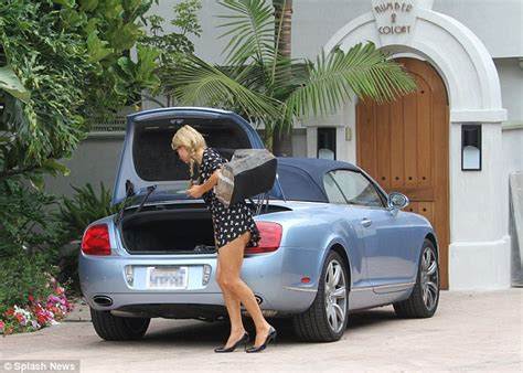 bentley celebrity homes paris hilton spotted with her blue bentley continental gtc