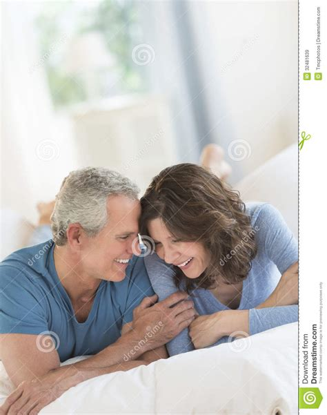 romantic couple in bed images romantic couple smiling in bed royalty free stock images