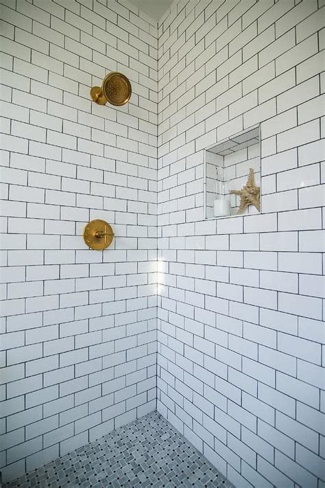 basketweave marble tile bathroom shower with white subway tiles and gray marble basketweave