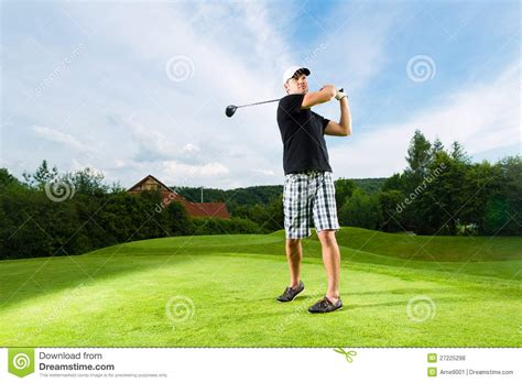 swing player young golf player on course doing golf swing royalty free