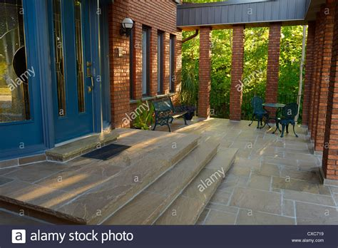 house with a porch stock photo image of chairs home 41010732 front blue door and stone porch of red brick house with