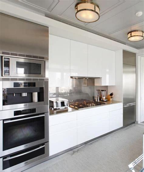 white kitchen with stainless steel backsplash stainless steel archives interior design new york