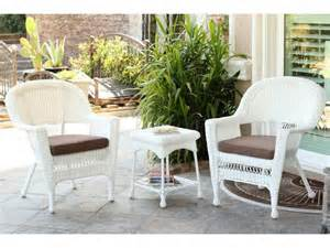 3 white resin wicker patio chairs and end table