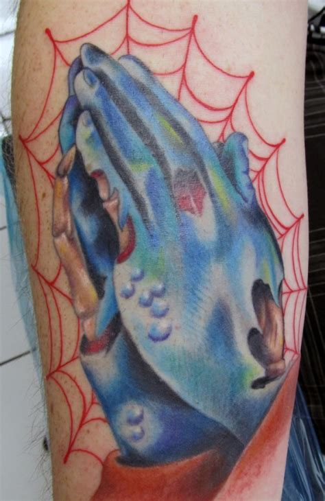 tattoo zombie hand 27 greatest praying hands tattoos pictures creativevore
