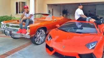 new school cars tyga and chris brown hanging out on lambo and impala