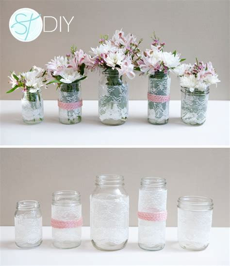 mason jar centrepieces with ribbon filled with flowers