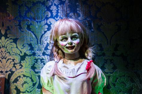annabelle doll horror meet annabelle and horror props at creepy new warner