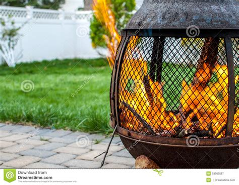 firepit in backyard with roaring stock photo image