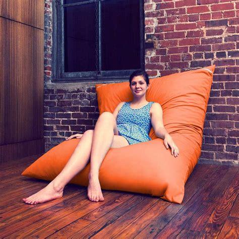 bright orange bean bag chair in purple or bright green apartment ideas