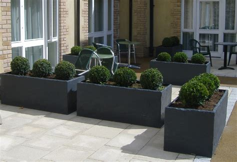 Modern Outdoor Planters by Slate Water Features Search