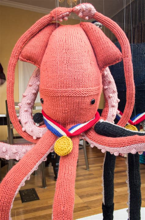 knitted squid create a winter olympics themed window display