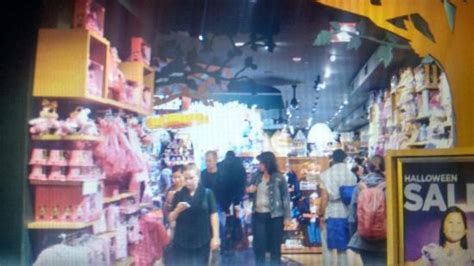 Disney Store City Floor - quotes line the ceiling on the second floor picture of