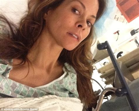 brooke burke covers her neck scar after successful thyroid