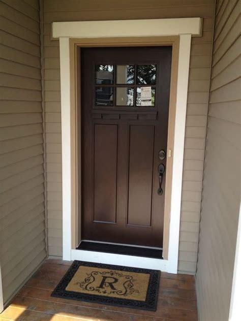 beautiful brown door dark hardware  black door step