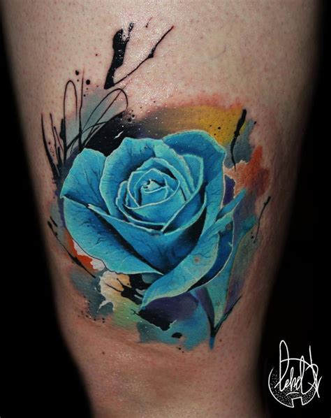 colour rose tattoos blue ink on thigh