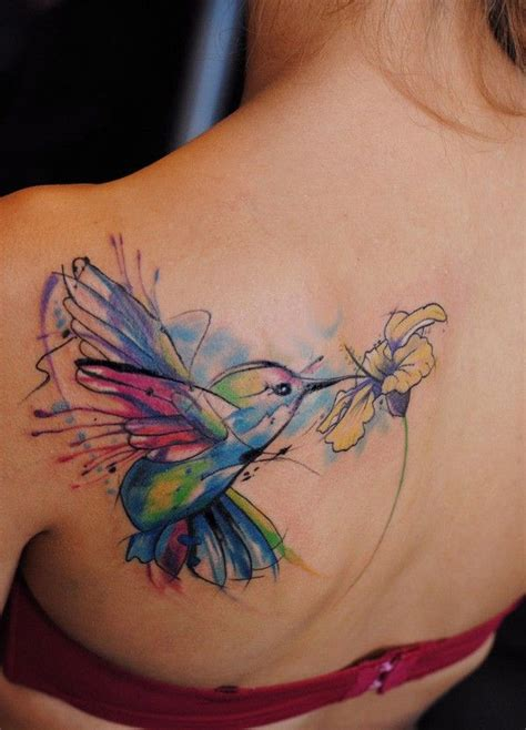 watercolor tattoo upper back flying hummingbird watercolor on back