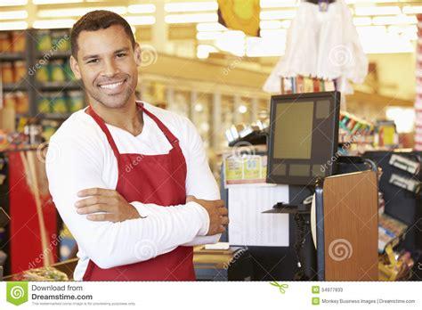 cashier at supermarket checkout stock image image 54977833