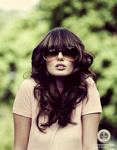 heavy bangs hairstyles heavy bangs and big curls and sunglasses make a plain t