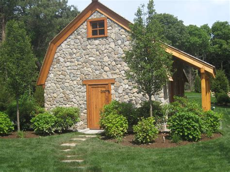 faux stone siding Exterior Traditional with circular