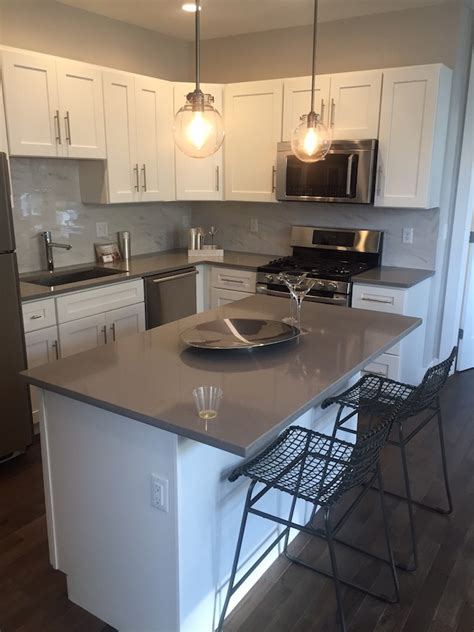 gray kitchen countertops with white cabinets elements of style blog marble splashback and gray quartz