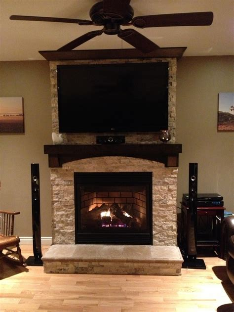 fireplace with stone stone on fireplace with tv mounted over mantle