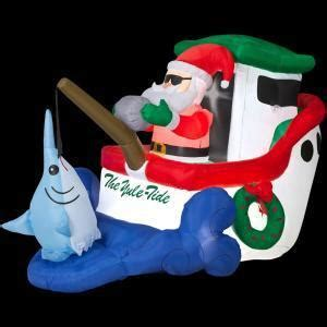 santa in a boat inflatable up on the housetop on christmas inflatable decorations