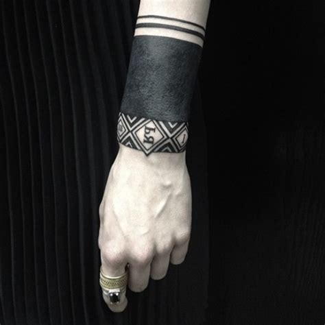 wonderful blackwork wrist tattoo by sasha masiuk