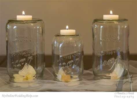 front view upside down mason jars with candles on top