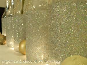 Diy glittered izze bottles perfect for vases and other decorations