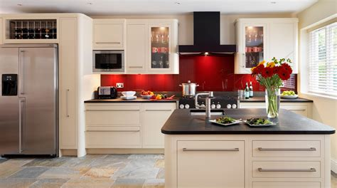 New Home Kitchen Design Ideas linear kitchen with red glass splashback from harvey jones