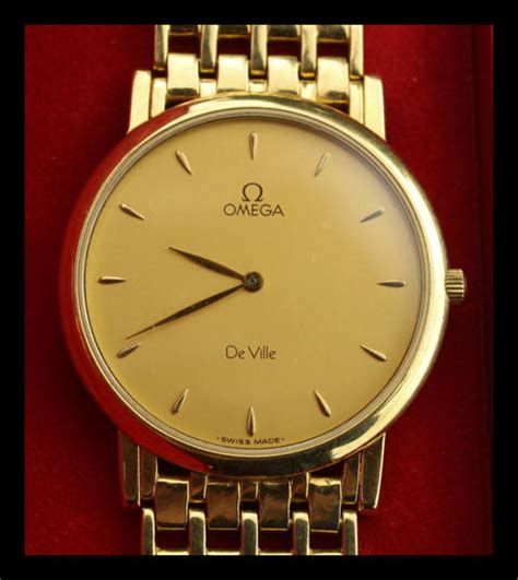 collectible watches 18 carat solid gold omega de