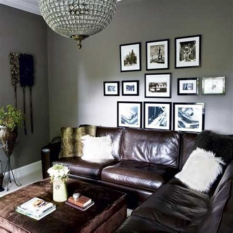 grey walls brown leather couch living room
