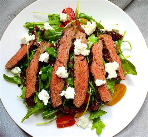 Summer Lunch Menu Ideas For Entertaining - grilled skirt steak salad with arugula balsamic glazed onions tomatoes and feta recipe