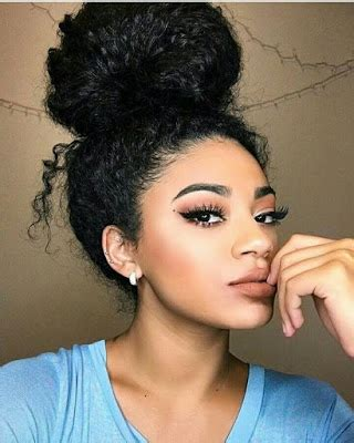 curly hair in high bun with bang natural and curly hair favorites the messy bun more