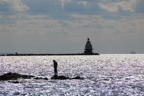 Five Mile Point Light by Five Mile Point Light Fisherman And Other Lighthouse