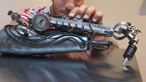 tattoo machine arm this amazing cyberpunk prosthetic arm is also a tattoo machine